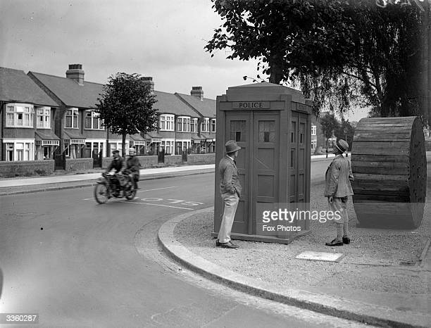 A police box on the corner of a suburban road is attracting the attention of passersby