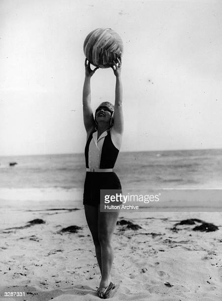 American actress Clara Bow the 'It' girl plays with her beach ball in front of her Malibu home