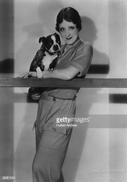 Irene Rich the stage name of Irene Luther the American silent screen heroine and star of 'Strangers May Kiss' with Boston Bulldog puppy in her arms