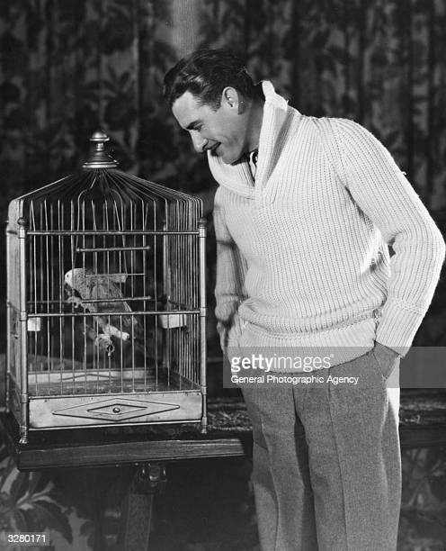 John Gilbert the US film star with his pet parrot