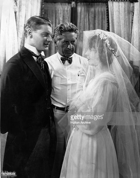 Lillian Gish Fred Niblo the director and Ralph Forbes the British leading man during the filming of 'The Enemy' for MGM