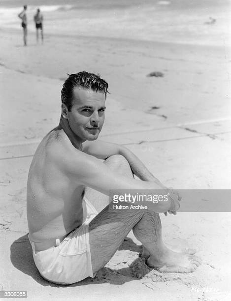 Neil Hamilton the Hollywood film actor and former model signed by MGM outside his Malibu beach cottage