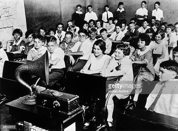 Students in an Atlanta school listening to the radio broadcasting a lesson in current affairs
