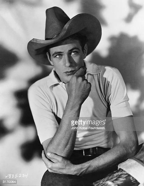 Thoughtful looking and heavily made-up Gary Cooper .