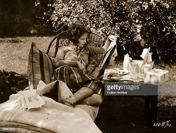 American actress Clara Bow the 'It' girl resting between shots during the filming of 'Wings'