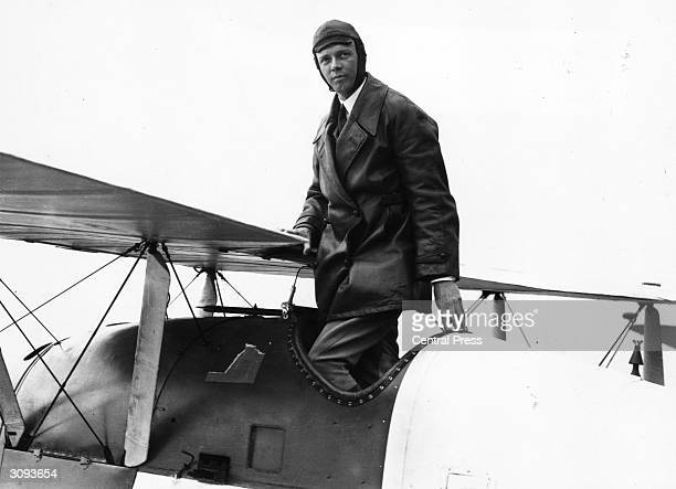 American aviator Colonel Charles Augustus Lindbergh , who in 1927 became the first person to make a non-stop solo flight across the Atlantic.