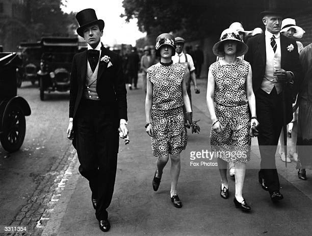 British photographer Cecil Beaton arriving with his sisters for the cricket match between Eton and Harrow at Lord's cricket ground London