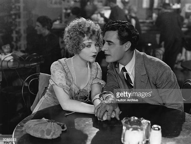 John Gilbert the stage name of John Pringle with Betty Compson in a love scene from the MGM film 'Twelve Miles Out'