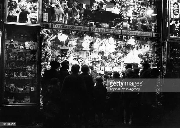 People looking at a window display at Hamleys toy shop in London