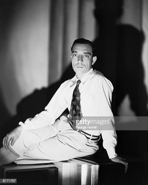 American silent screen comedian and actor Buster Keaton reclines with a deadpan expression