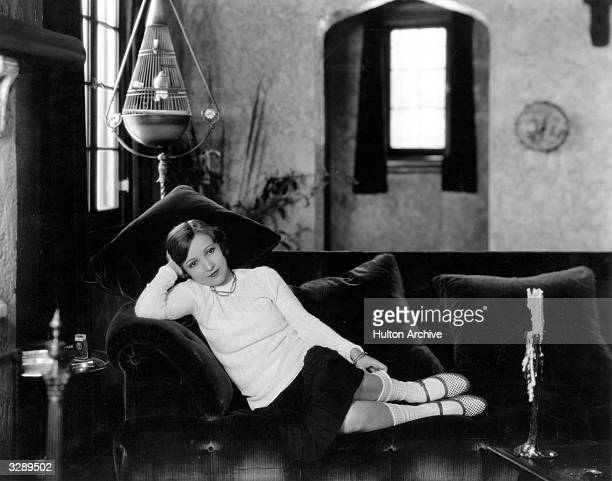 Bessie Love the Hollywood actress who appeared in 'Dress Parade' relaxes in a chair in her Hollywood home