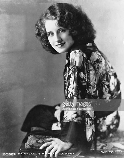 Canadian actress Norma Shearer wearing a floral patterned silk dressing gown