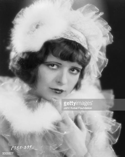 Clara Bow in a frilly hat and matching dress