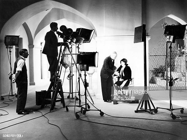 Clarence Brown the American director is directing Lewis Stone the distinguished American leading man of silent films and Dorothy Sebastian in a scene...