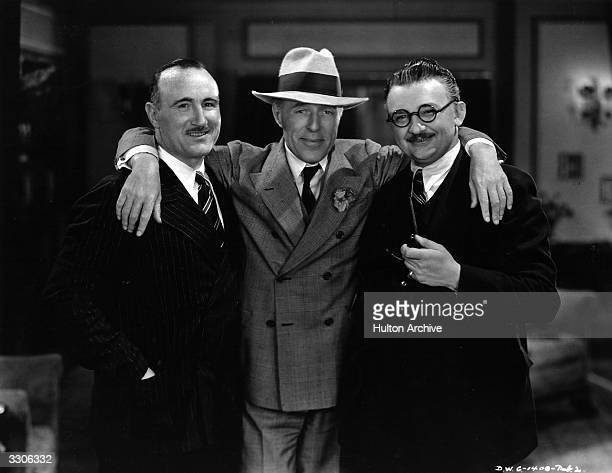 David Wark Griffith , the first great Hollywood film director and producer puts an arm round actors Donald Crisp , left, and Jean Hersholt . Griffith...