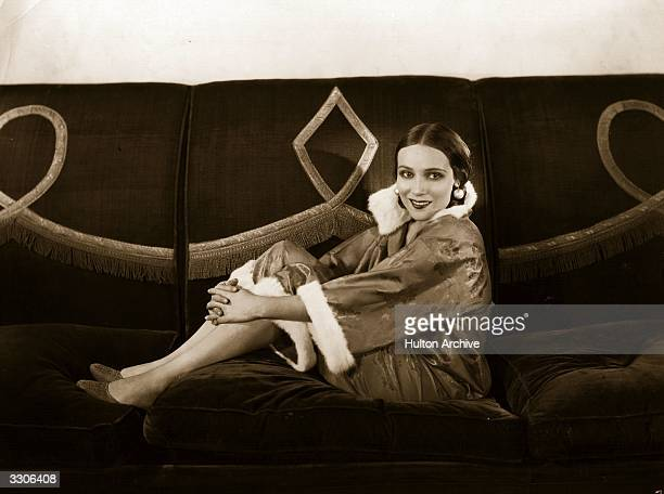 Dolores Del Rio Hollywood film star and wife of MGM's Art Director Cedric Gibbons. Sitting on her sofa in her drawing room.