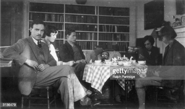 From left to right Jimmy Doggart Frances Marshall Alec Penrose Lytton Strachey Frances Penrose and Dora Carrington taking tea at Ham Spray in...