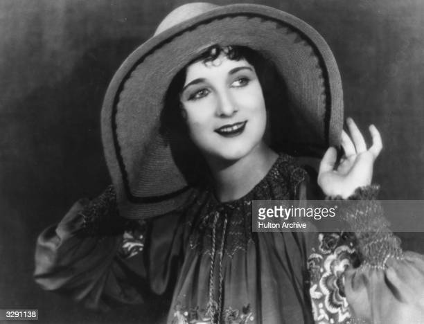 Gertrude Olmsted the actress and silent screen heroine is wearing a cheesecloth blouse and a large brimmed Mexicanstyle hat