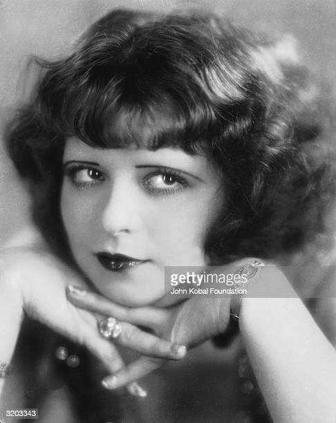 Hollywood film actress Clara Bow rests her chin on her hands