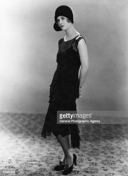 Joan Bennett American leading lady of the 30's and 40's who was at one time married to Walter Wanger Featured modelling a charlestontype dress and...