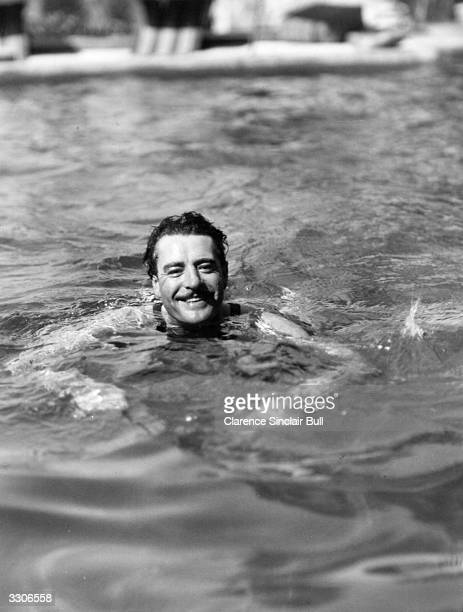 John Gilbert the MGM star in his swimmimg pool at his home in Beverly Hills California The film 'A Star Is Born' was based on his life story