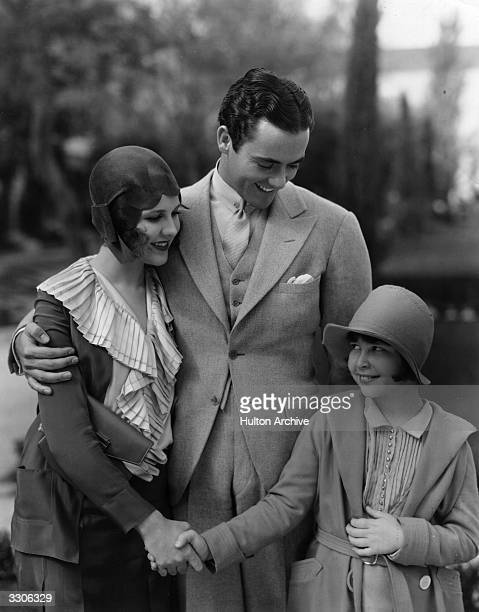 Mitzi Green the child performer, Charles Buddy Rogers, the leading man and Mary Brian, the leading lady meet at the Paramount film studios. Mitzi...