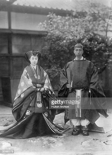 Prince Takamatsu or Prince Nobuhito of Takamatsu brother of Emperor Hirohito of Japan with his bride Miss Tokugawa Kikuko at their nuptial ceremony...
