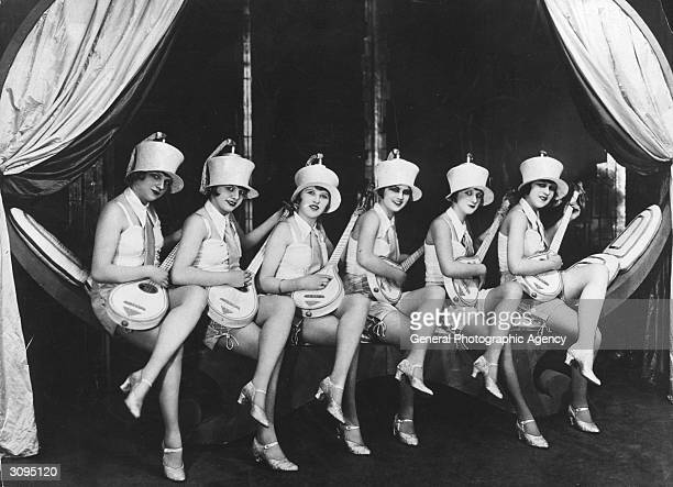 Six costumed Berlin jazz girls performing with mandolins at a revue show