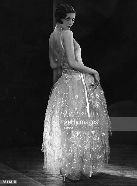 Model wearing a Norman Hartnell evening gown.