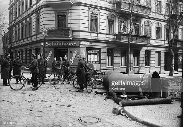 Police cycle patrol guarding one of Berlin's barricaded streets.