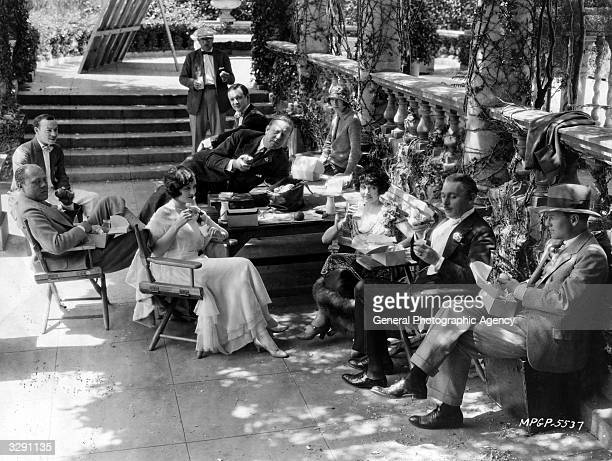 Australian actress Mae Busch with Creighton Hale Lew Cody and director Robert Z Leonard during a break in the filming of 'The Comedian'