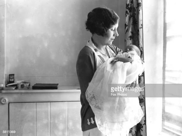 Barbara Cartland with her new baby Raine.