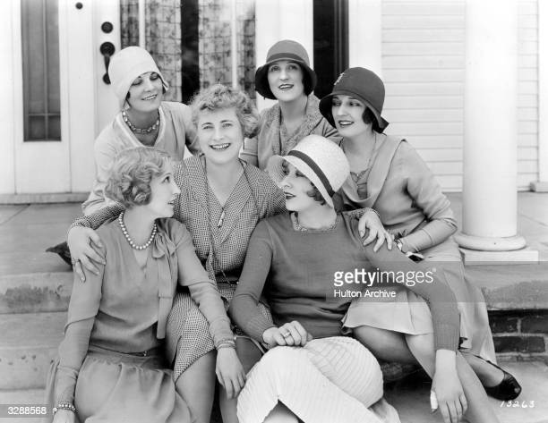 Bessie Love the Hollywood actress who appeared in 'Dress Parade' poses with Leatrice Joy and other friends at her Hollywood home