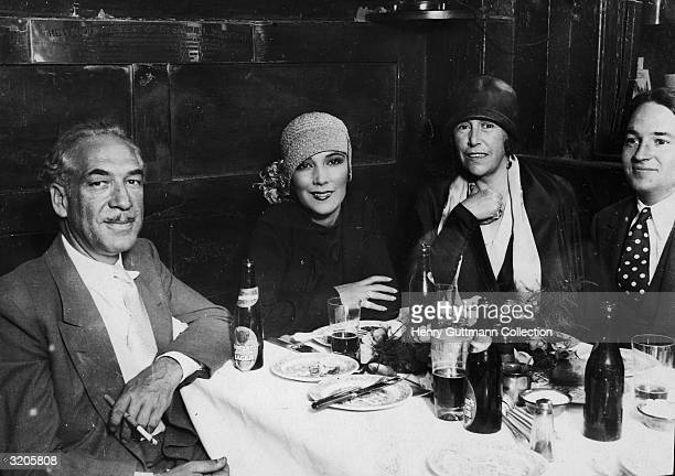 Hollywood film star Dolores Del Rio with friends at the Olde Cheshire Cheese pub in Fleet Street London Above the group is a brass plaque to mark...