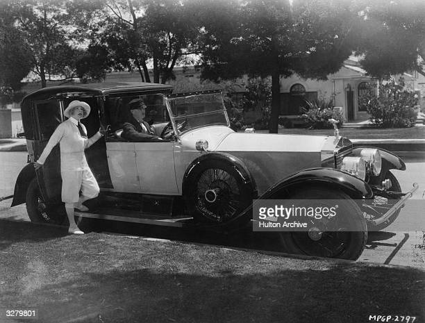 Mae Murray the radiant Hollywood film star and actress signed by MGM Seen about to board her Rolls Royce