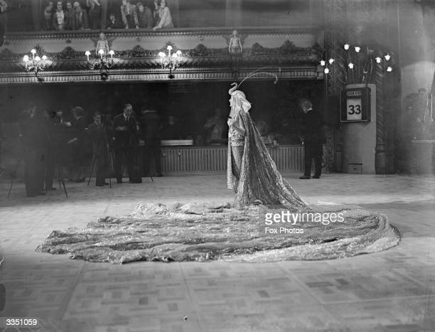 Mrs WoolleyHart dressed as Cleopatra in an extravagant fancy dress outfit for the Joy Of Life ball at The Royal Opera House Covent Garden