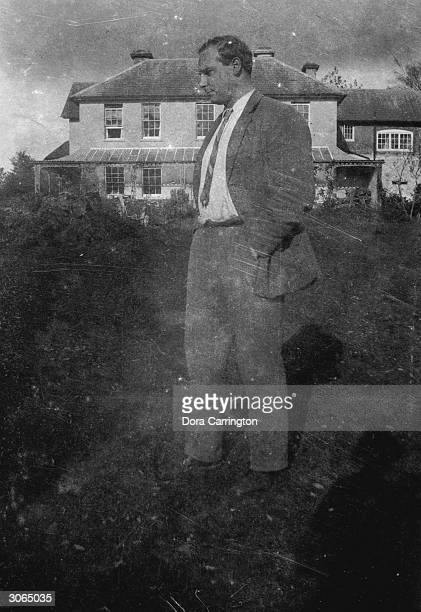 Ralph Partridge on the lawn at Ham Spray in Wiltshire home of Dora Carrington and Lytton Strachey and associated with the 'Bloomsbury Group' circle...