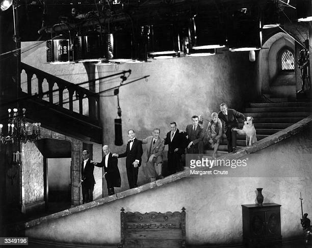 Stars of the Paramount film 'The Insidious Dr Fu Manchu' take a break from filming to pose on the winding stairs of the set. From top to bottom they...