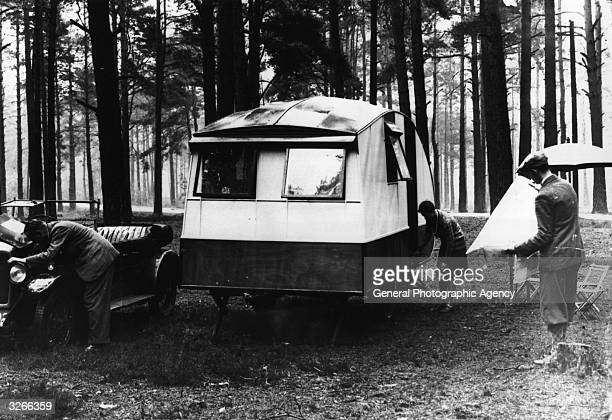 A family setting up its caravan for a night's camping at Lynmouth in Devon
