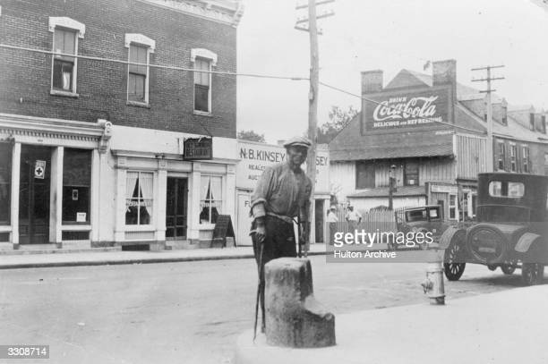 A former slave standing by a slave block in Fredericksburg Virginia on which slaves stood to be auctioned off to the highest bidder