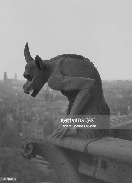 A Gargoyle on the cathedral of Notre Dame on the Ile de la Cite in central Paris