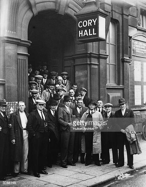 A group of men waiting to enter Cory Hall for a Coal Conference in Cardiff