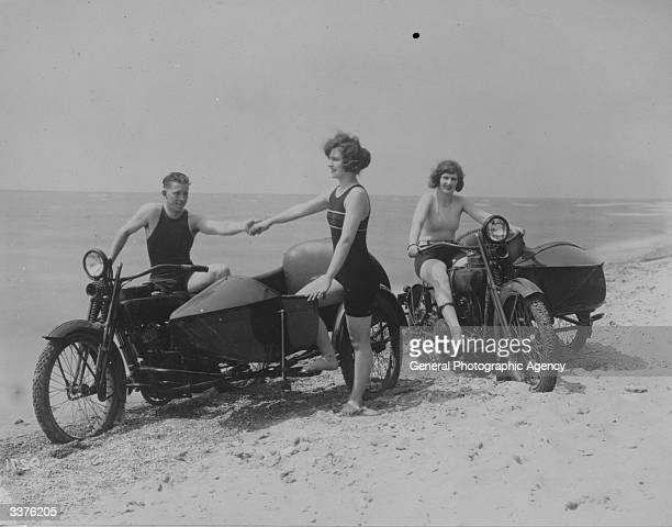 A group of young people on a Californian beach with their motorcycles and sidecars