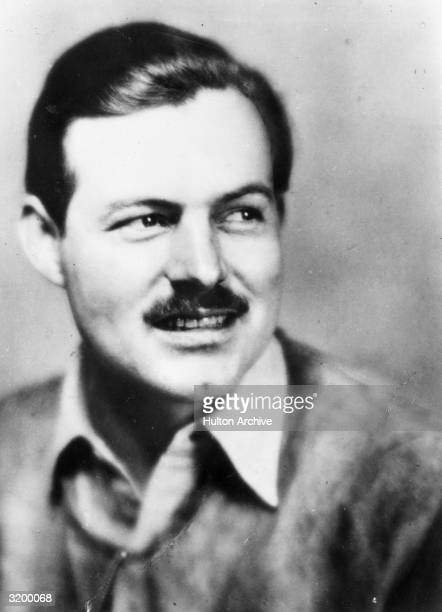 A headshot of author Ernest Hemingway as a young man