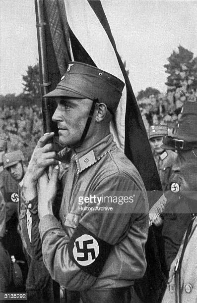 A member of the SA the paramilitary wing of the Nazi Party at a rally