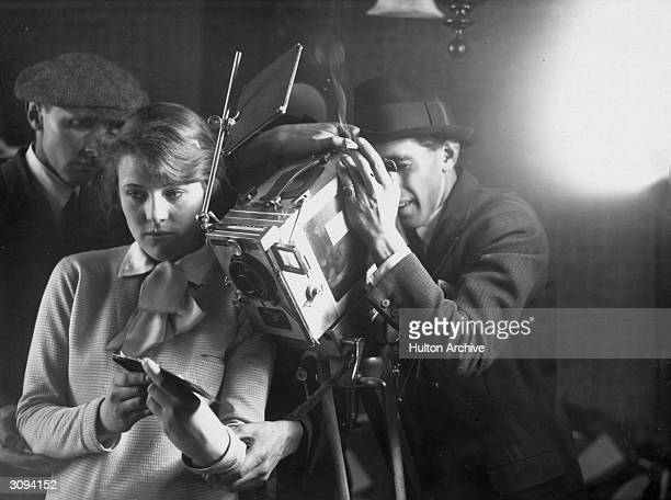 A production assistant holds a card up in front of the camera during a shoot