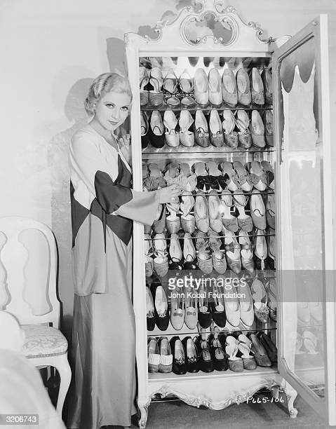 A starlet with her extensive collection of shoes arranged in a special mirrored closet