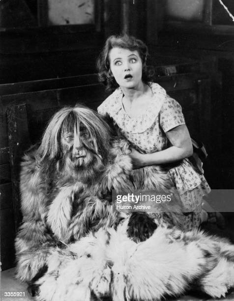 A startled woman clutches a man in a furry beast costume from an unknown film