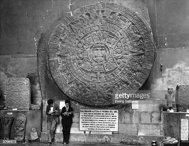 A stone Aztec calendar of the sun on display at the National Museum