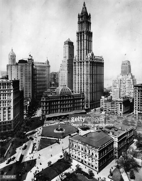A view of upper downtown New York with the Woolworth Building dominating its surroundings On the left of it is the Transportation Building to the...